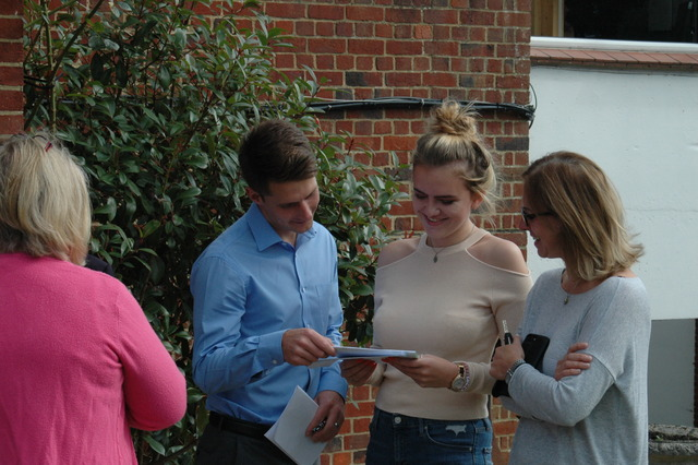 Alton Convent School's Amber Jones delighting in her GCSE results with Head of Sixth Form, Mr Sanderson.
