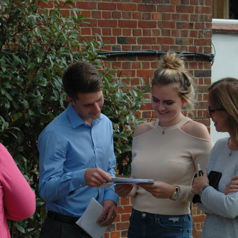Alton Convent School's Amber Jones delighting in her GCSE results with Head of Sixth Form, Mr Sanderson.