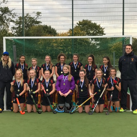 Bishop's Stortford College U16 Girls Hockey County Champions with Head of Girls' Hockey Nick Prowse and Performance Hockey Coach Kaye Goulding