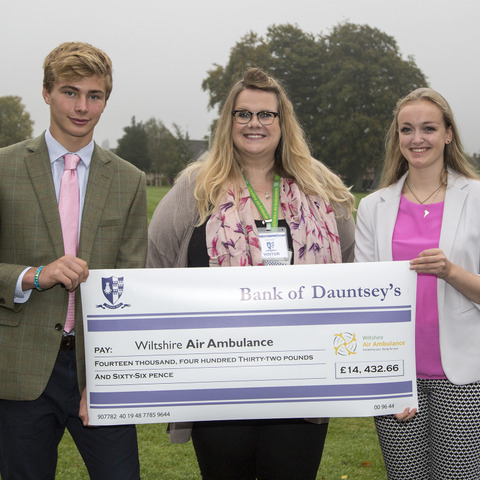 Pupils from Dauntsey's sixth form present a cheque for more than £14,000 to Jemma Brown of the Wiltshire Air Ambulance, the School's chosen charity fo