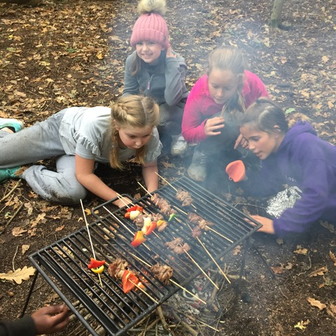 Cooking lunch over the fires they lit