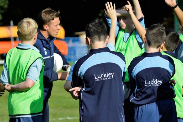 Matt Humphrey withthe football squad