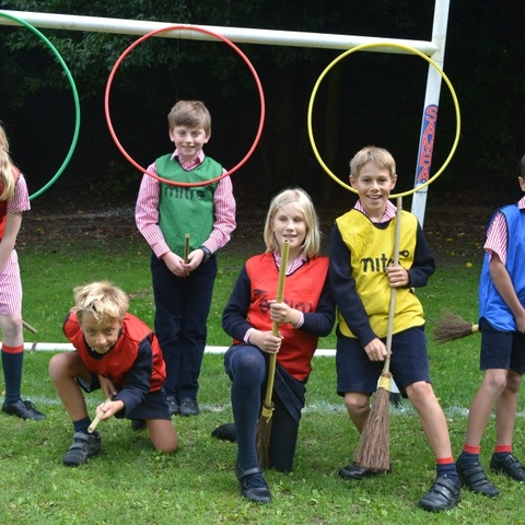 Hester and her classmates ready for a game of quidditch