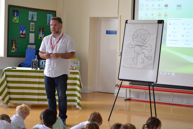 Curtis Jobling demonstrates how to draw Raa Raa the Noisy Lion for pupils at The Elms